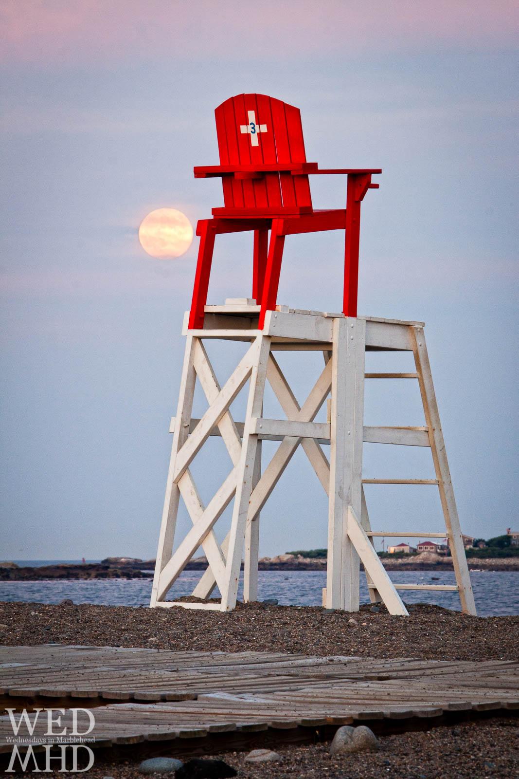 The Sturgeon Moon rises over Devereux Beach