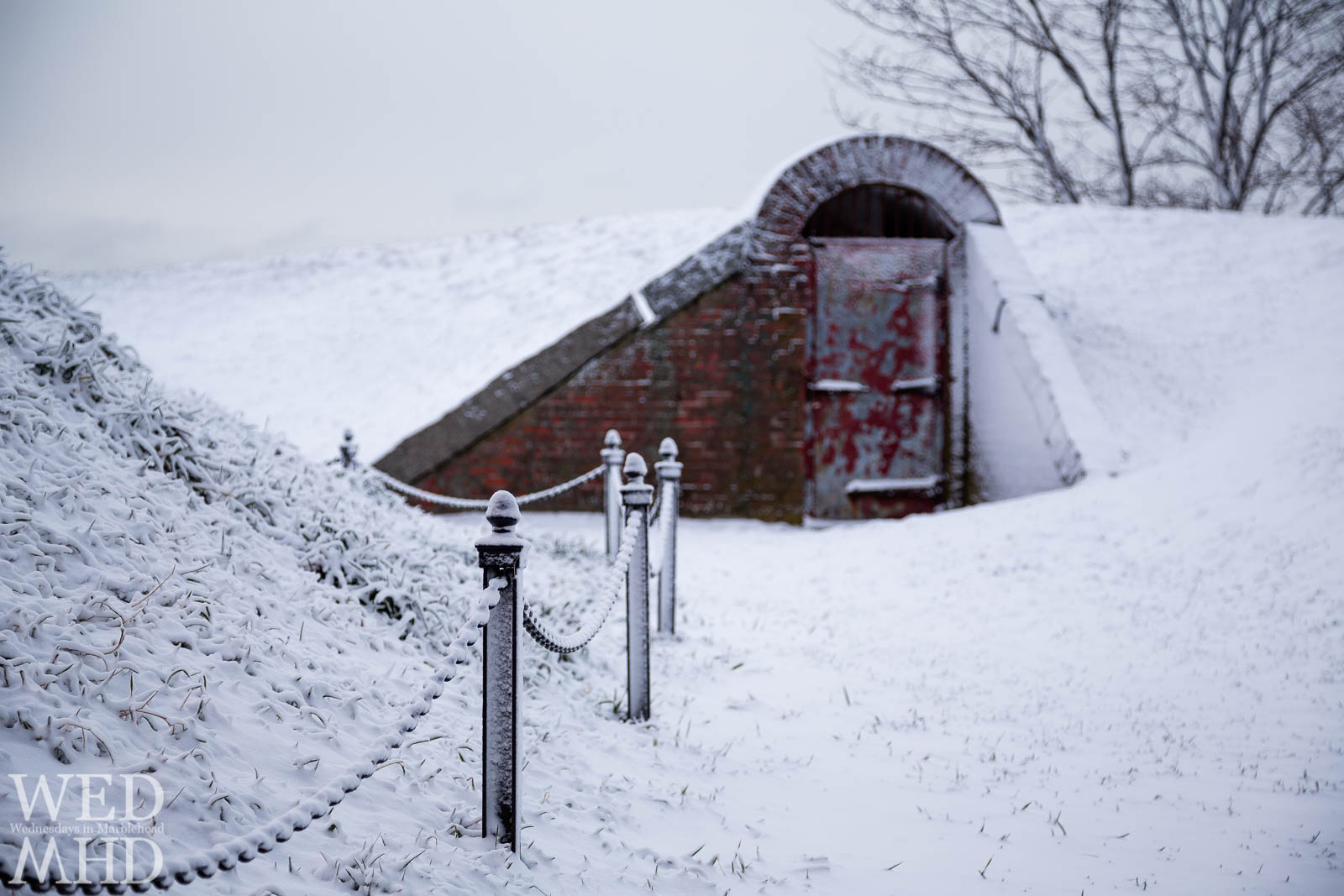The Red Doors of Fort Sewall in the Snow