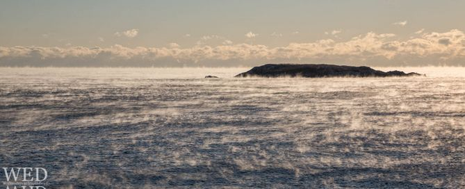 sea smoke around island