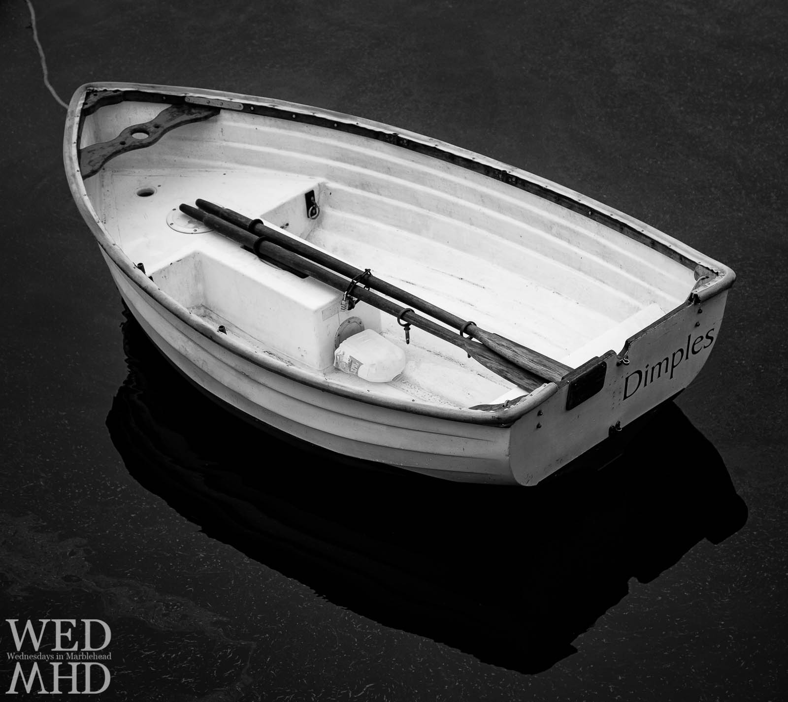 black and white rowboat