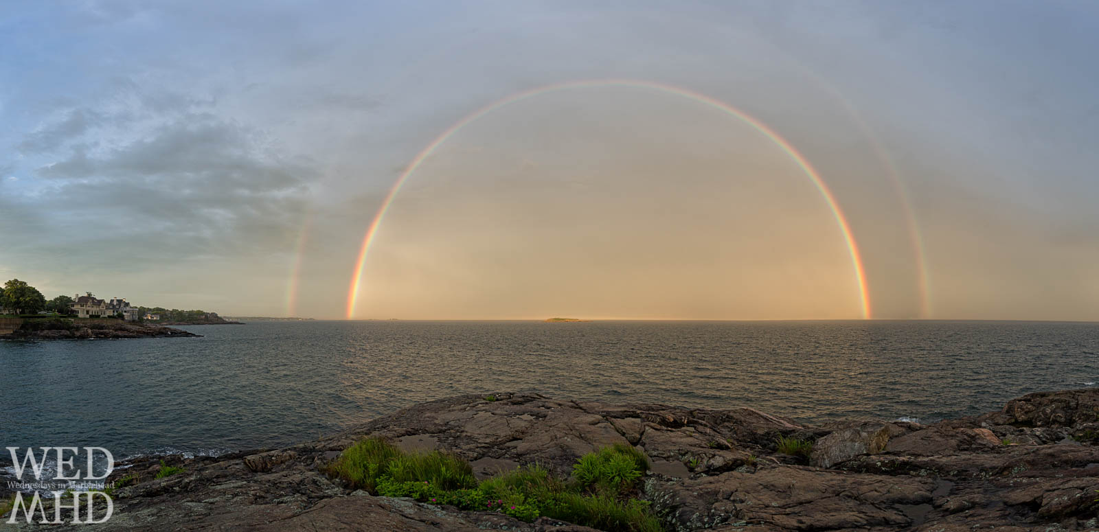 full double rainbow over water