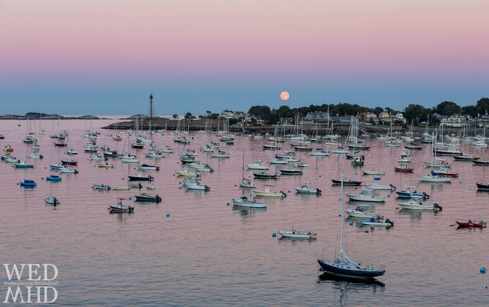 Harvest moon over harbor