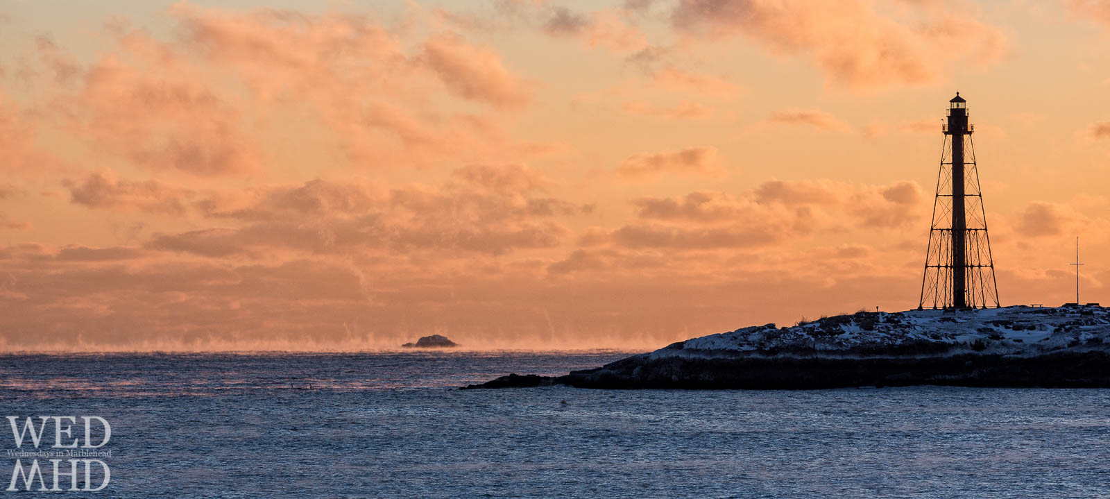 Sea Smoke and Orange Clouds at Marblehead Lighthouse