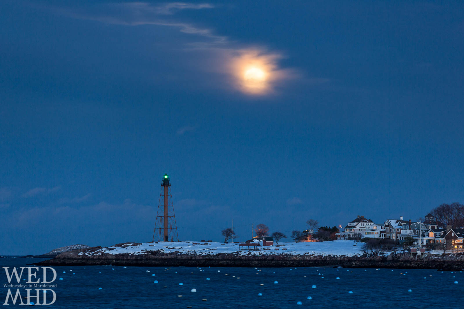 Snow Moon rises over snow covered Marblehead Neck