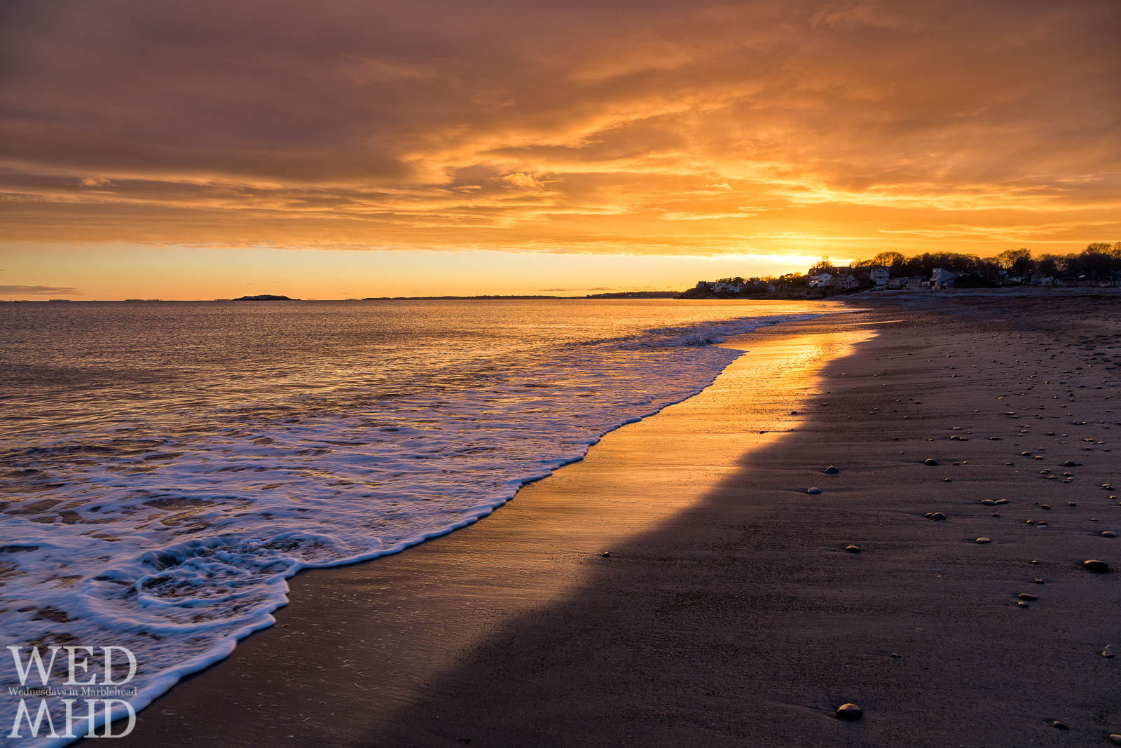 golden sunset takes shape over beach in Marblehead