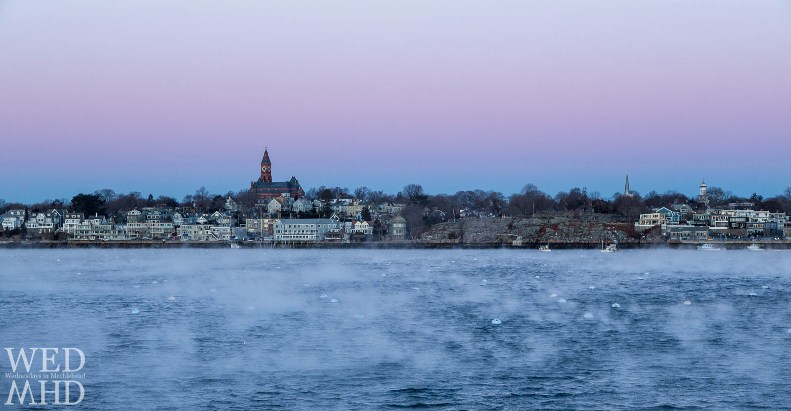 seas smoke fills Marblehead Harbor with Abbot Hall in the distance