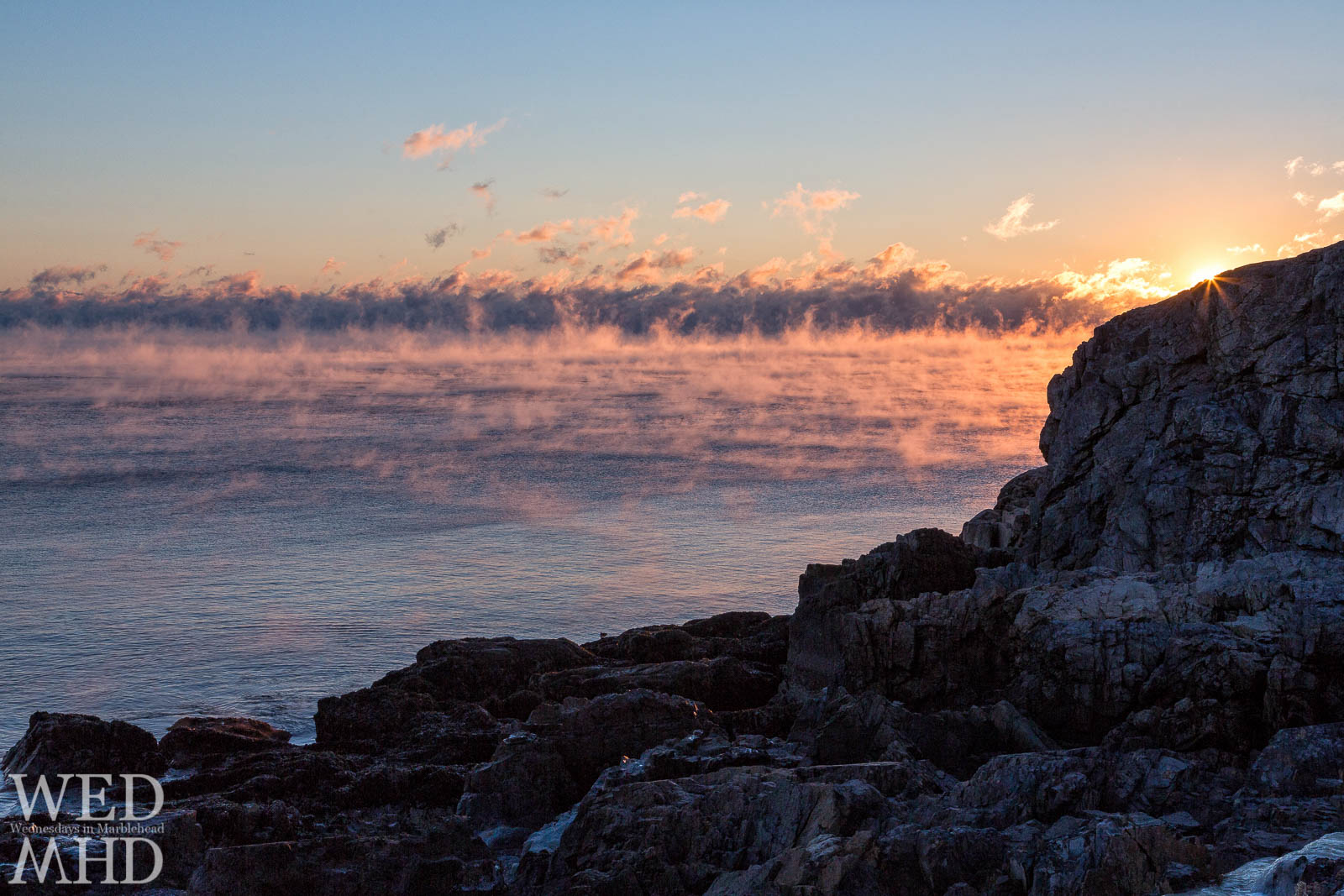 sunrise lights up sea smoke on the Atlantic ocean
