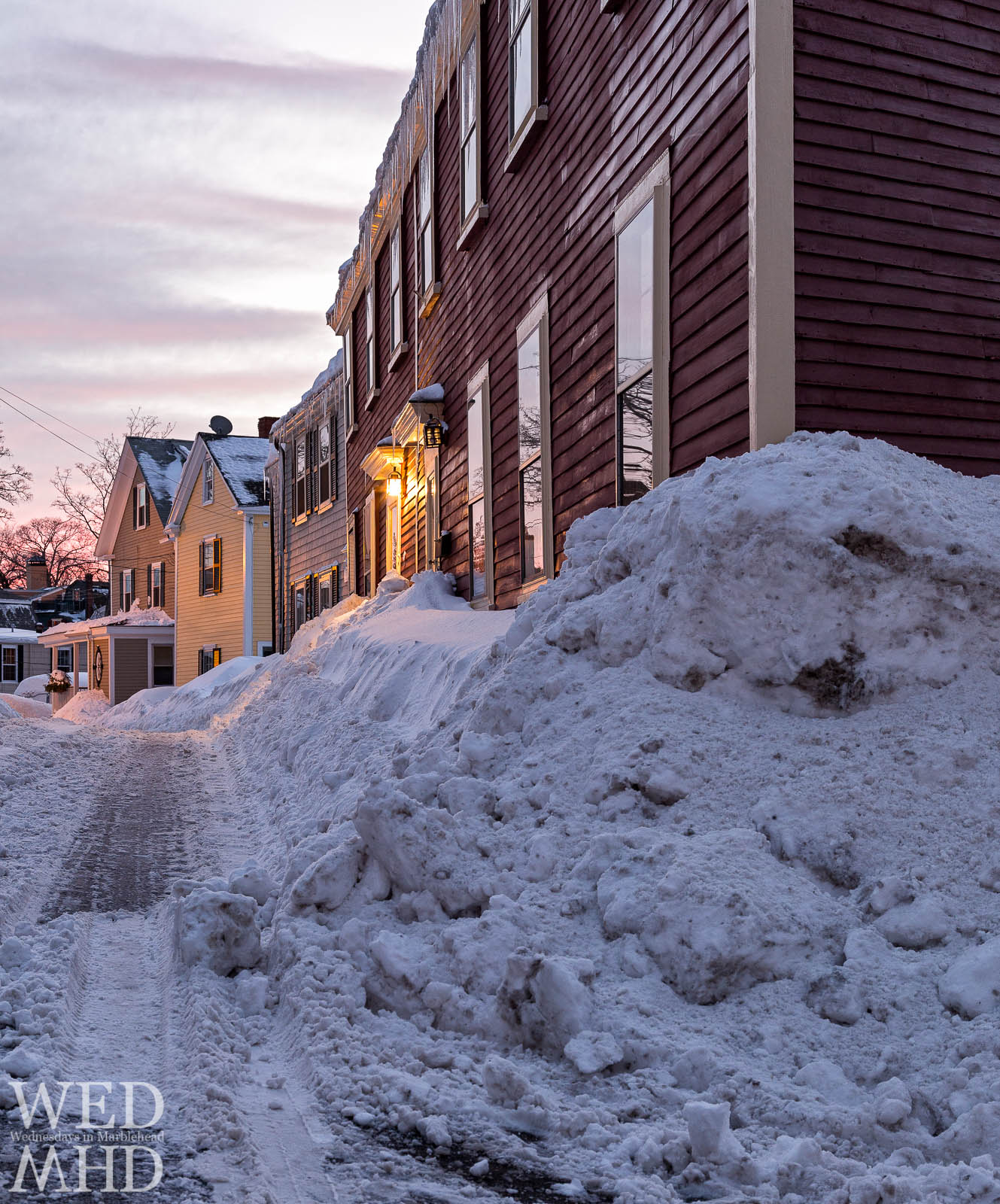Snow builds up on the corner of Front and Darling Streets in Marblehead