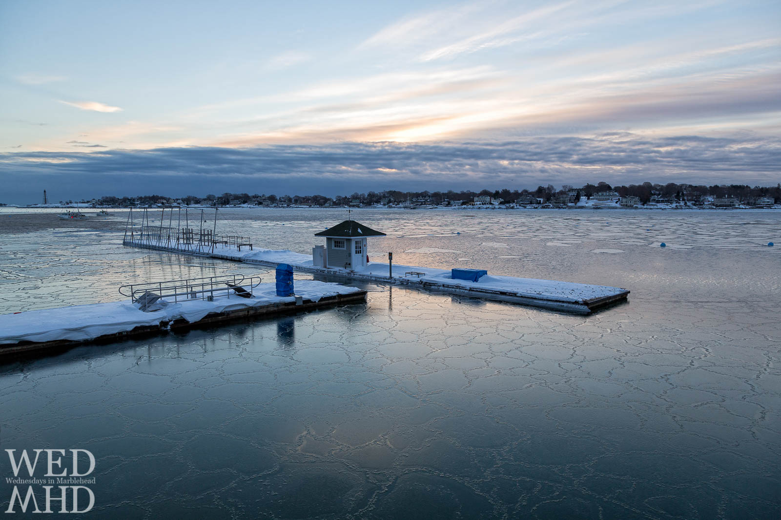 Marblehead Harbor nearly frozen and reflecting the sunrise colors