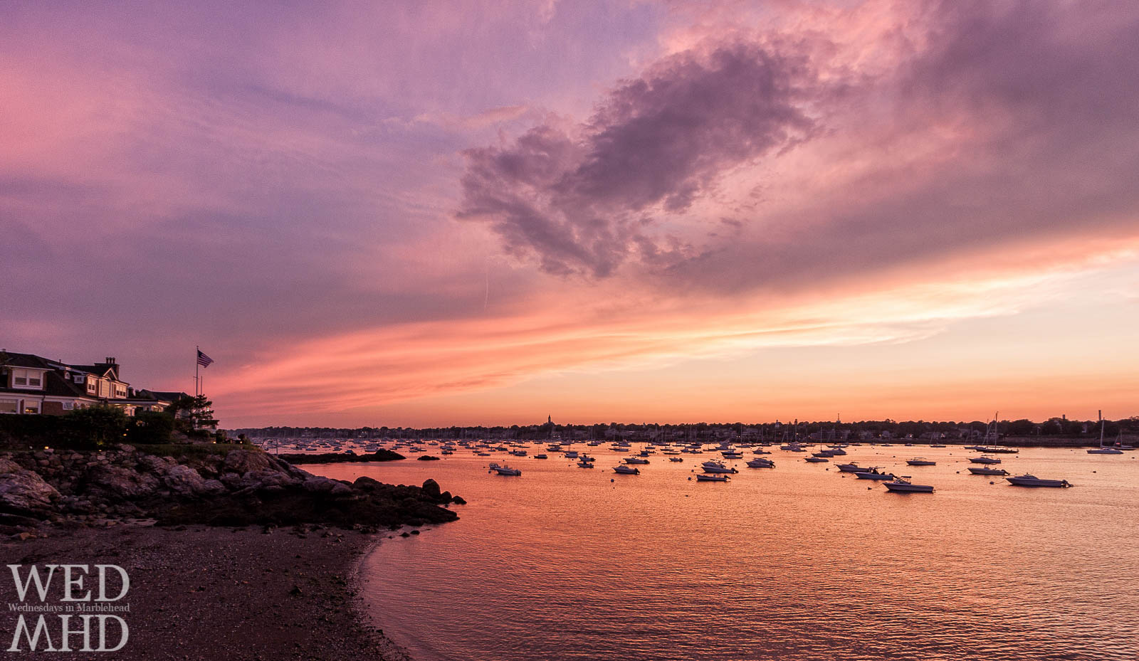 A purple sunset is captured on a warm Summer night in Marblehead