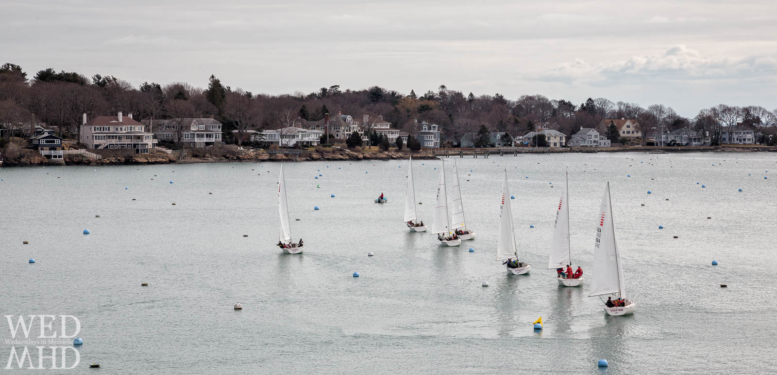 An image of boats practicing within Marblehead harbor during frostbite sailing