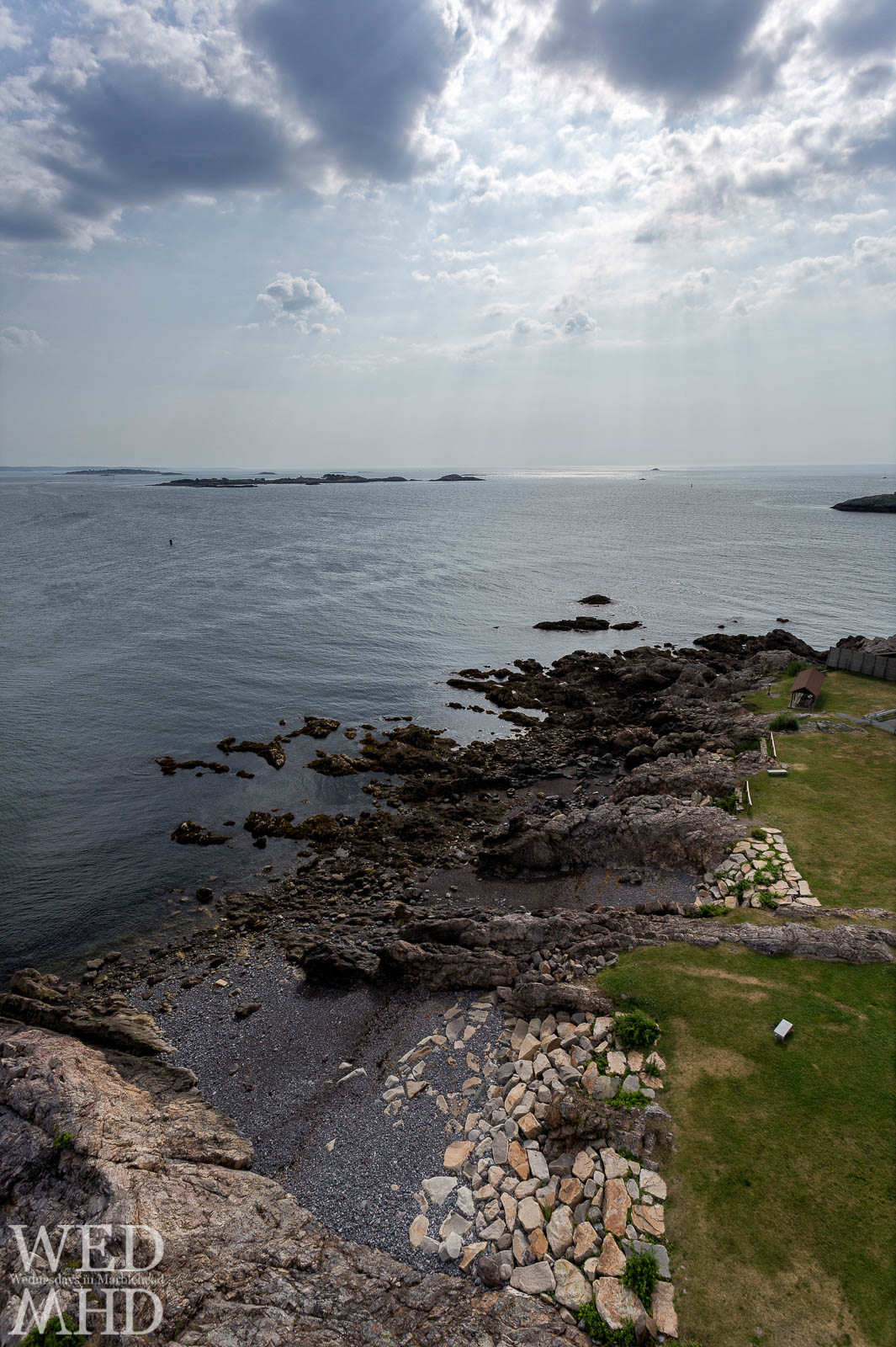Rays of light shine over Childrens Island as seen from atop Marblehead Light