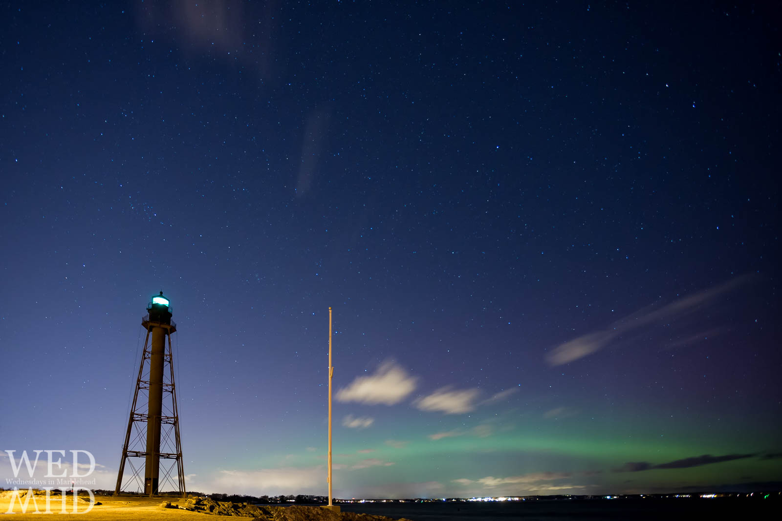 The green glow of the aurora borealis is on display in this view from Marblehead, Massachusetts