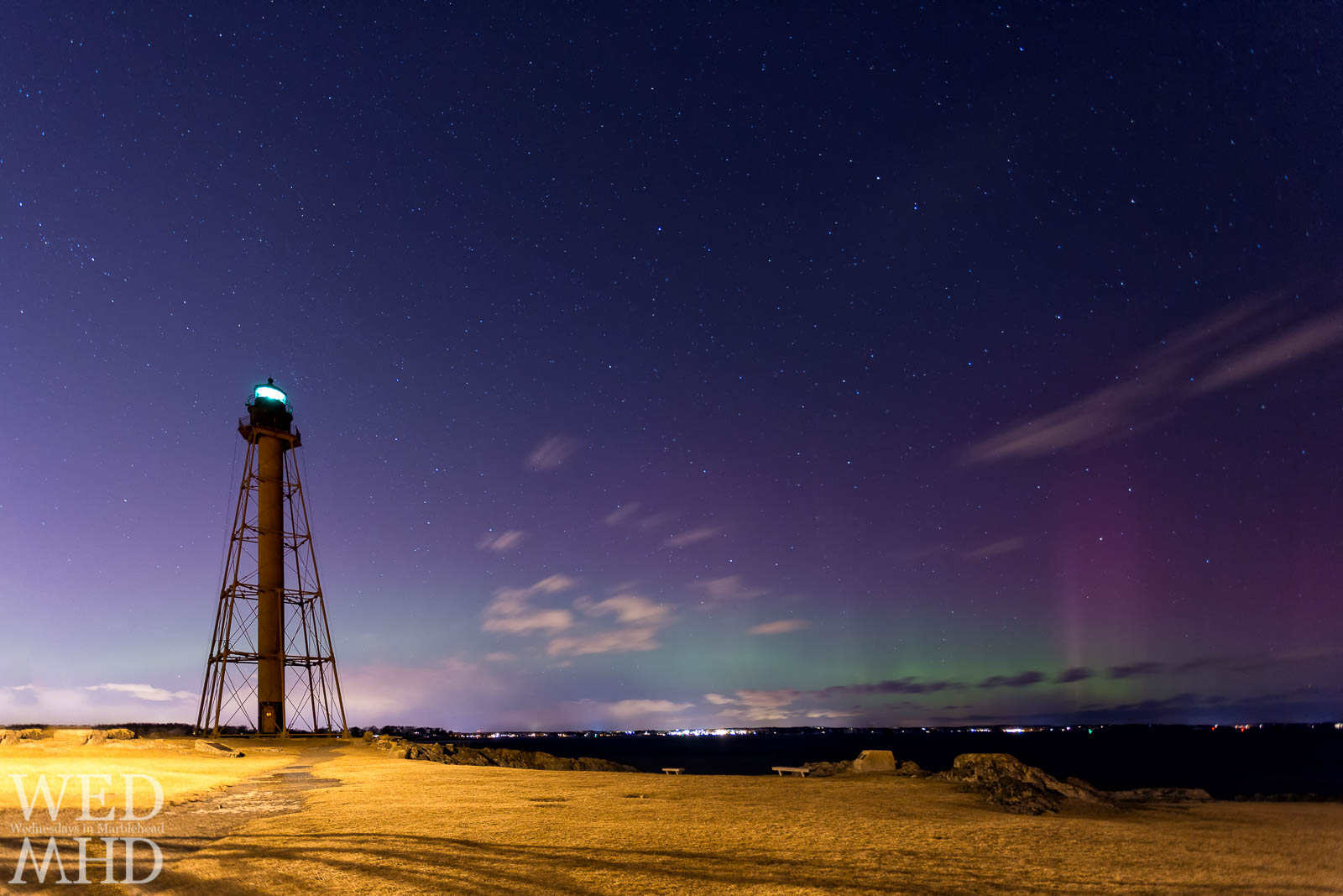 The aurora borealis (northern lights) shine green and purple in this image from Marblehead Light