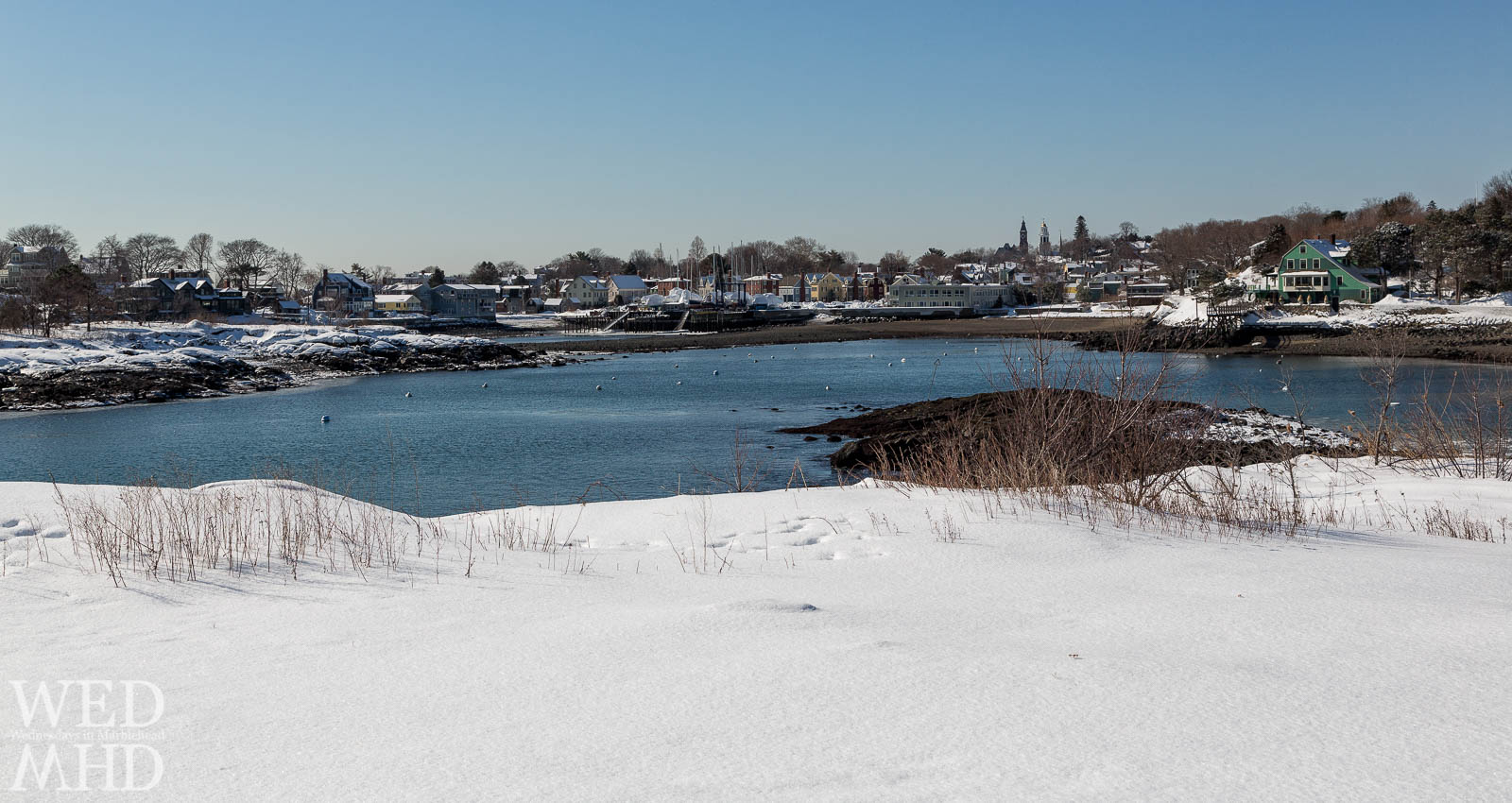 Marblehead blanketed by snow as seen from Brown's Island