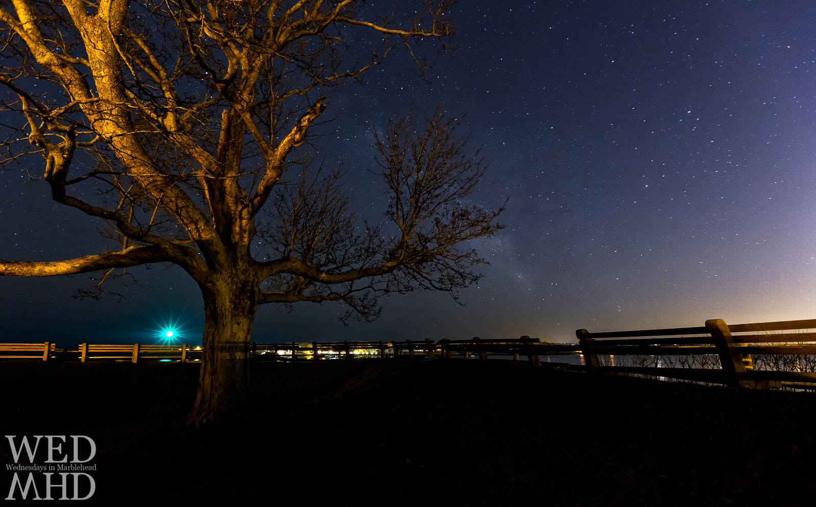 The night sky is filled with stars and a hint of the Milky Way in this view from Fort Sewall