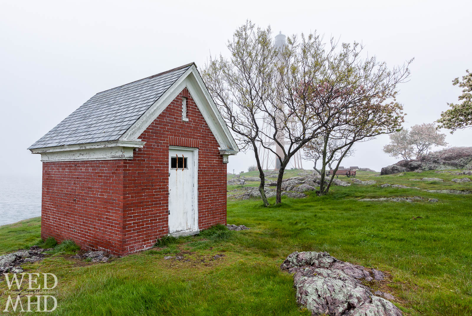 The old oil house on Chandler Hovey Park seen on a foggy Spring day