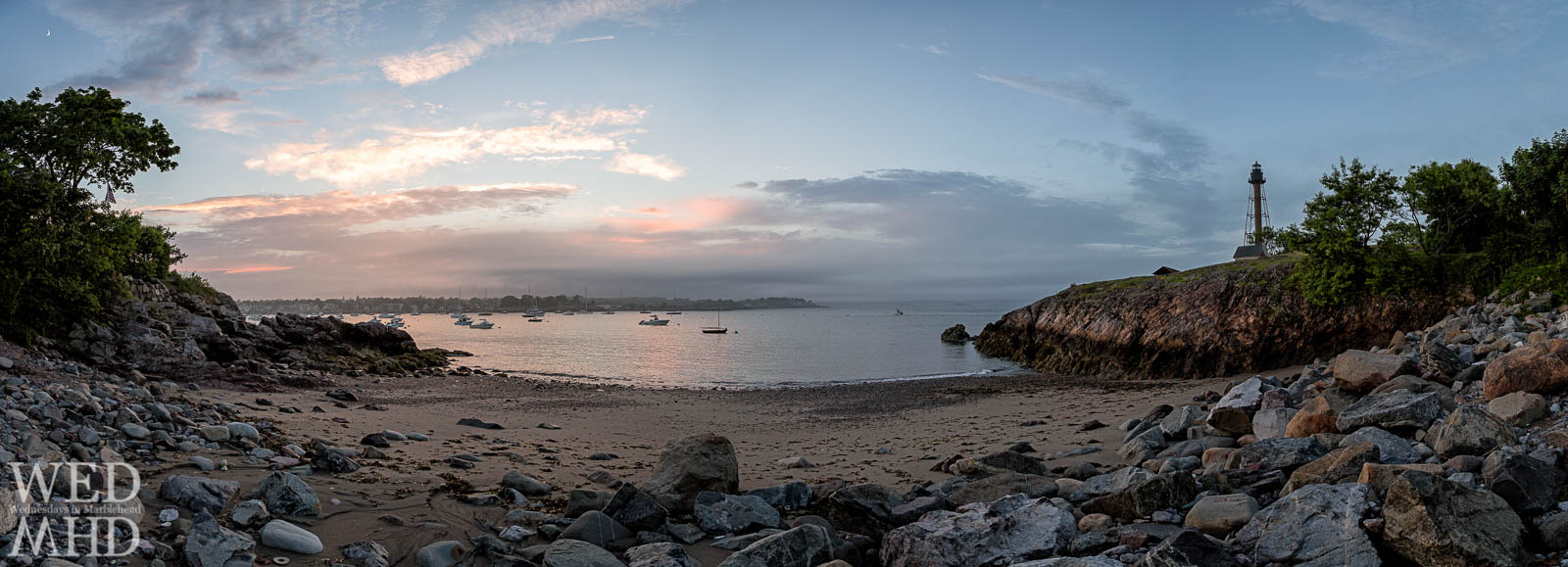 The secret beach at Cove Lane is captured in this panorama encompassing Marblehead Light, the harbor and crescent moon