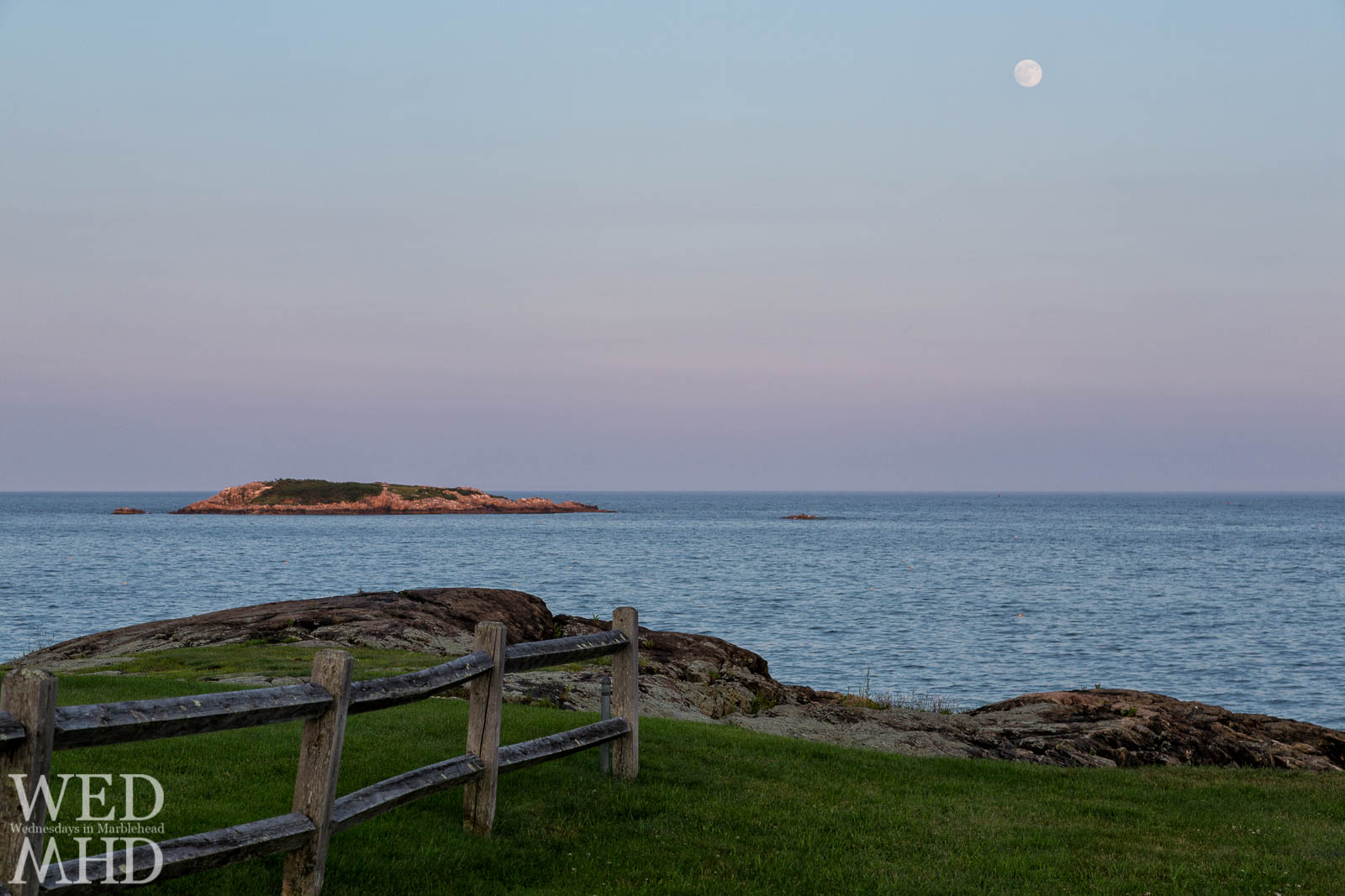 The moon rises over Rams Island in this view from Bass Rock Lane