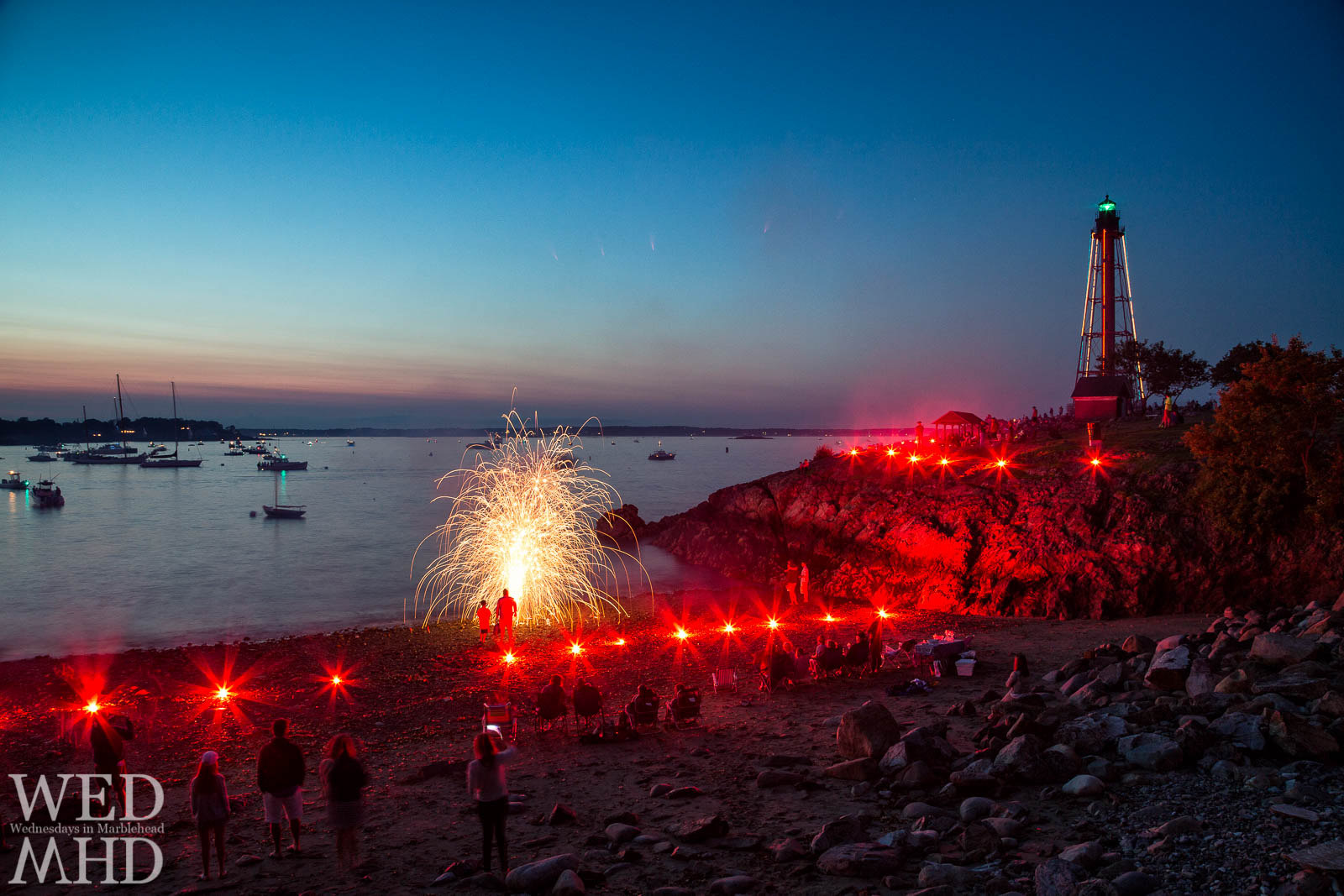 Marblehead's traditional harbor illumination takes place before the fireworks show on the Fourth of July