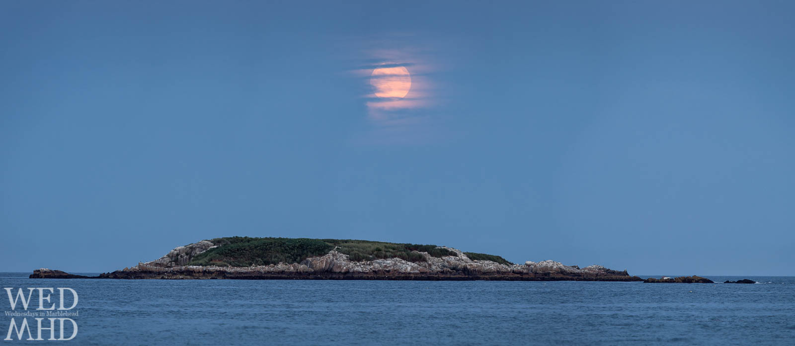 The full moon rises over Ram Island on a late Summer evening