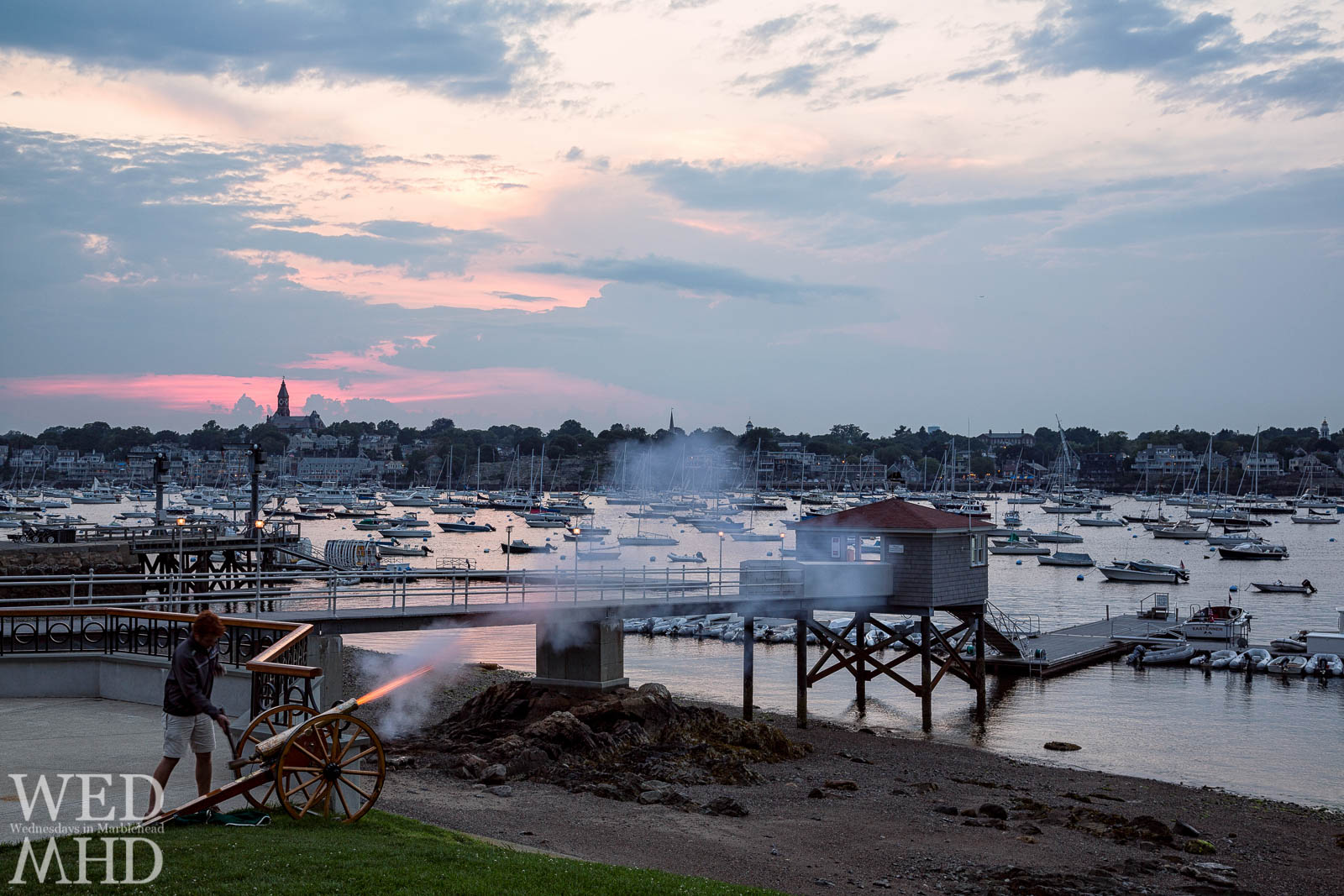 The sunset cannon is fired at sunset throughout the Summer by the five yacht clubs surrounding Marblehead Harbor