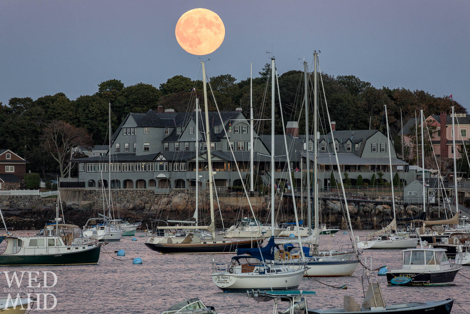The Harvest moon rises over the Corinthian Yacht Club as a prequel to the total lunar eclipse