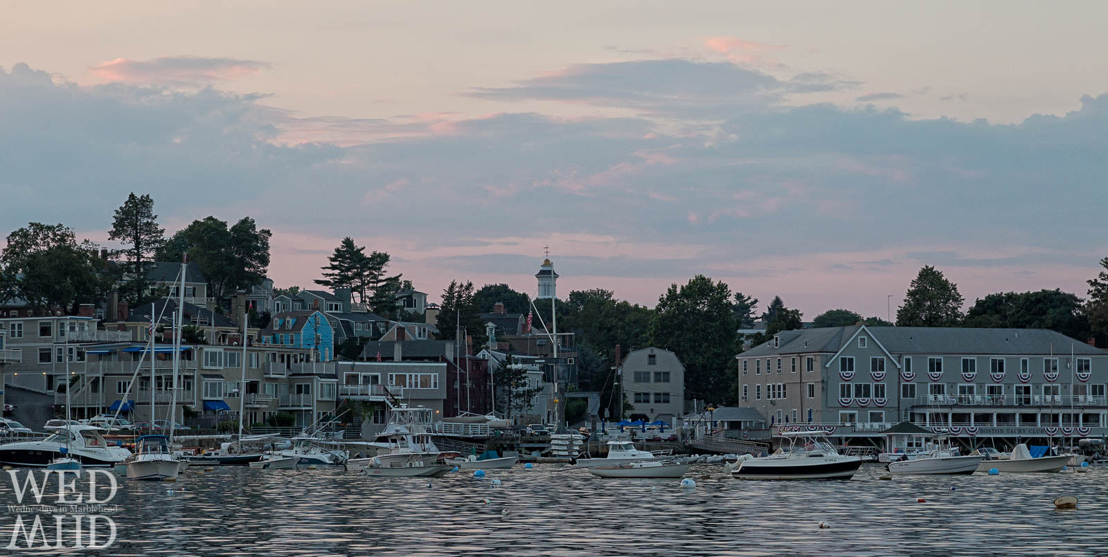 The Boston Yacht Club, Grace Community Church and houses on Gregory Street seen at the end of a Summer day
