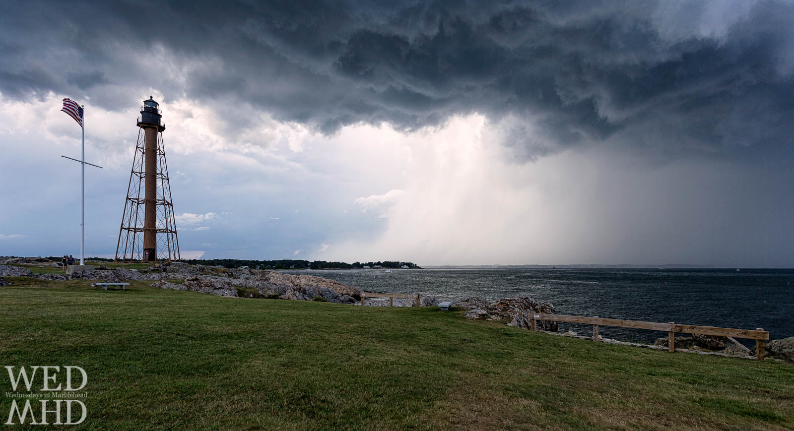 Grey clouds from a passing storm form a churning sky over Marblehead LIght