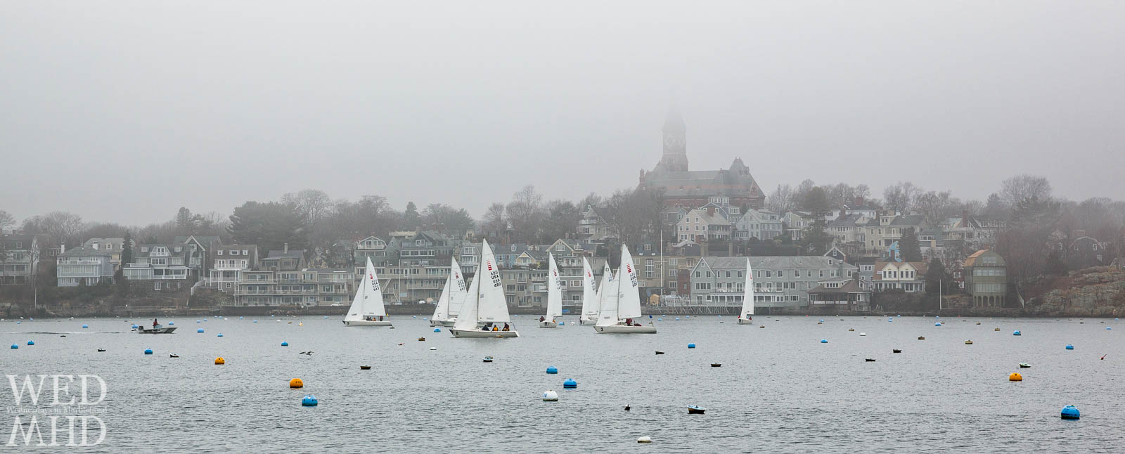 Frostbite sailing earns its name on this cold and foggy January day in Marblehead Harbor