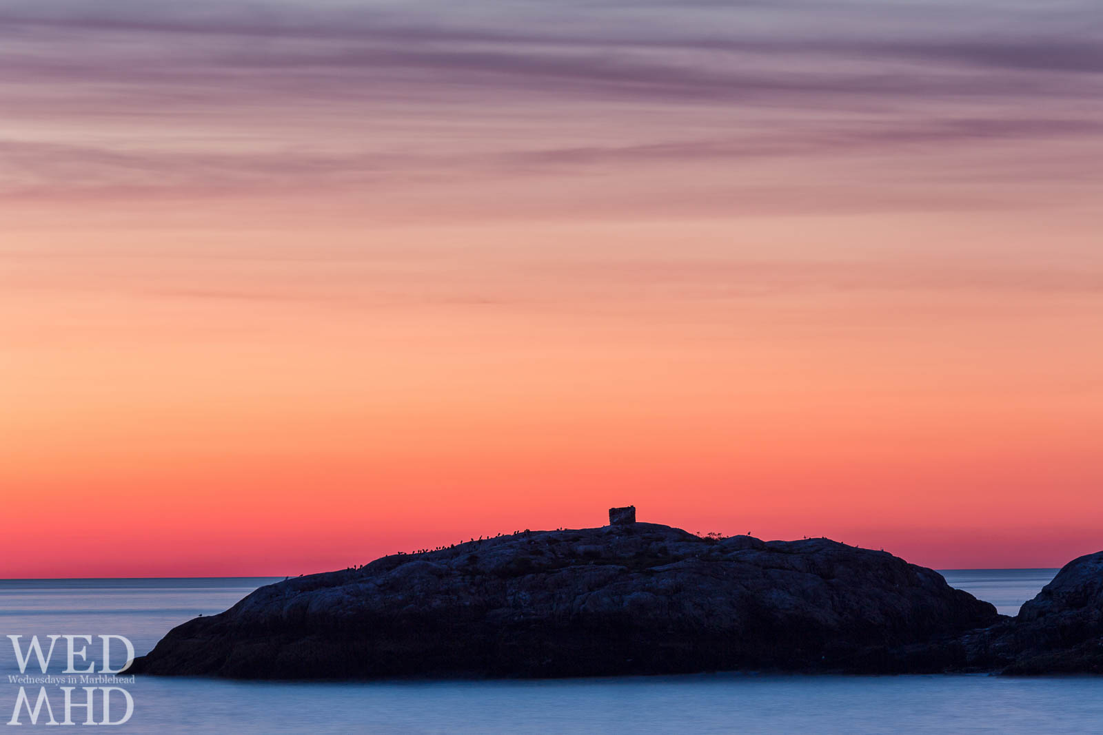 Dawn colors and smooth waters surround Marblehead Rock in this long exposure image