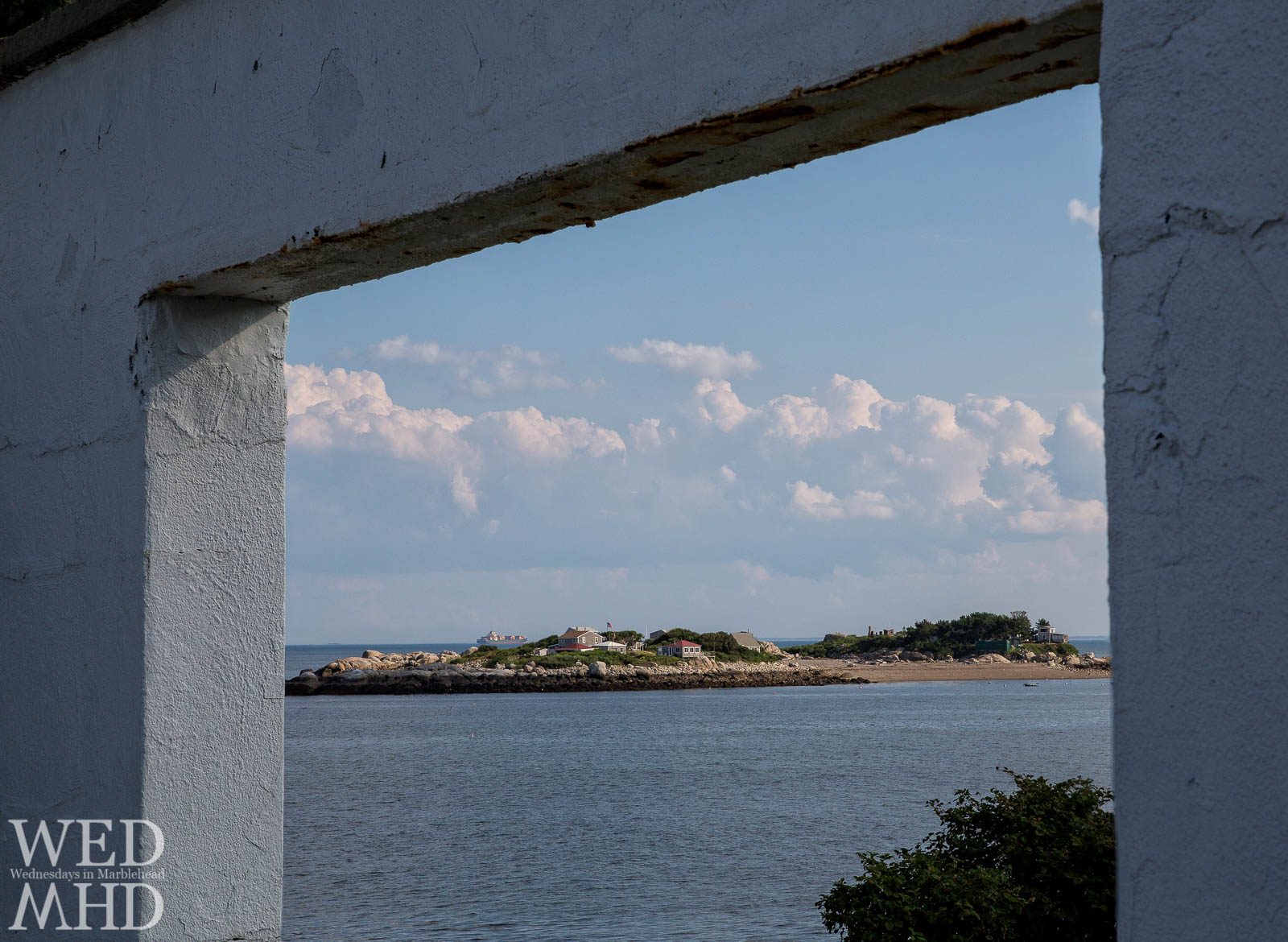 An archway frames this view of Tinker's Island