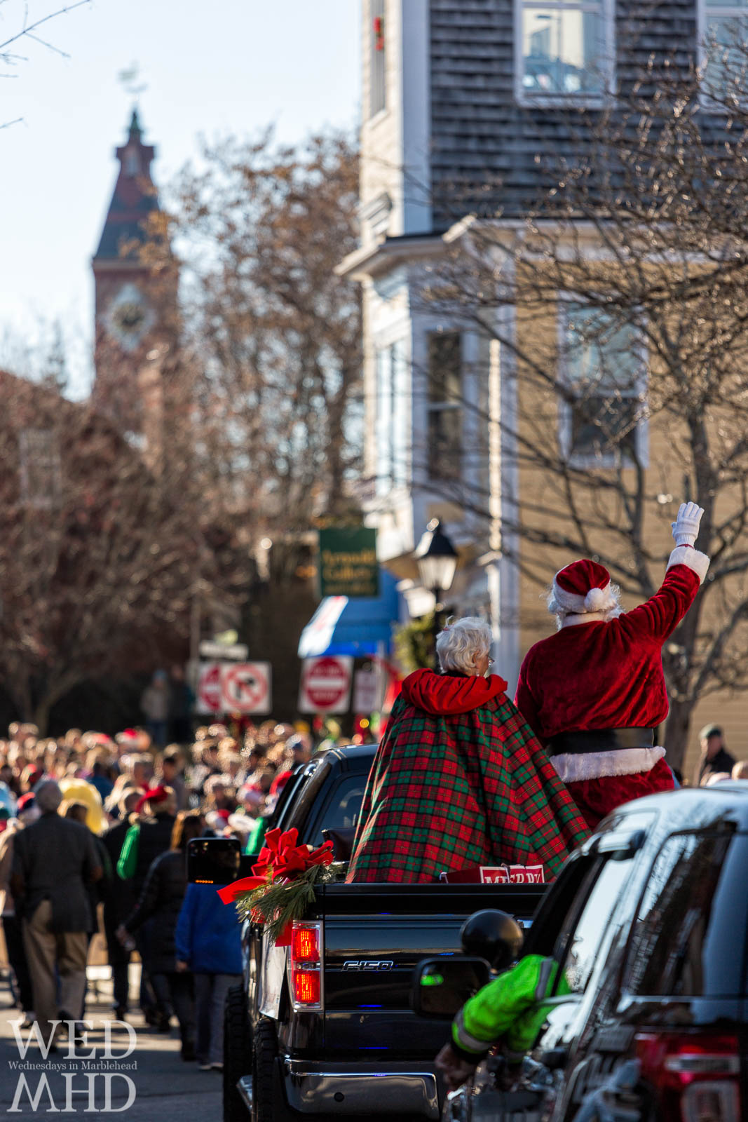 Santa and Mrs. Claus wave to the crowds along Washington Street in historic downtown during the annual Marblehead Christmas Walk parade