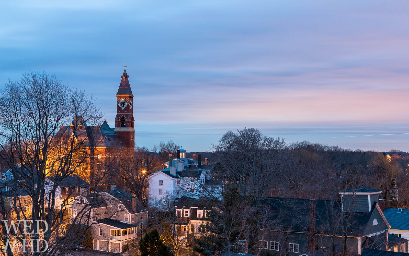 The glowing light of dawn illuminates Abbot Hall in this view from atop St. Michaels steeple