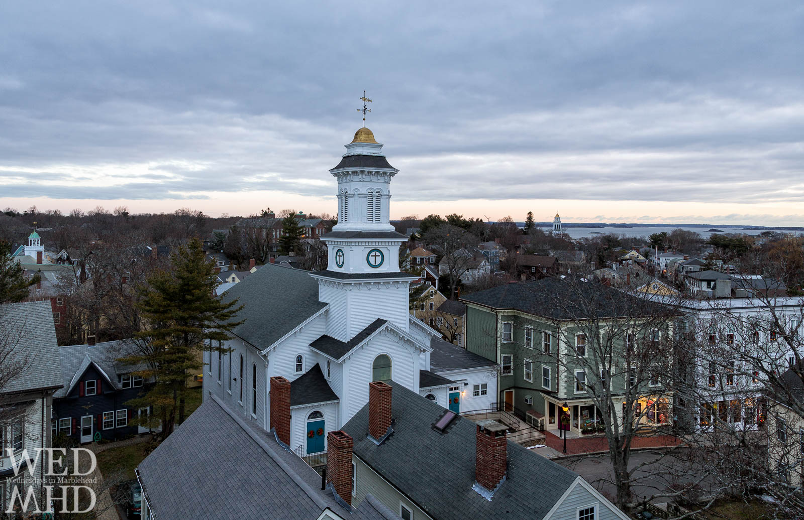 A view of Pleasant Street at dawn from atop St. Michael's steeple showcases Grace Community Church and stores in historic downtown Marblehead