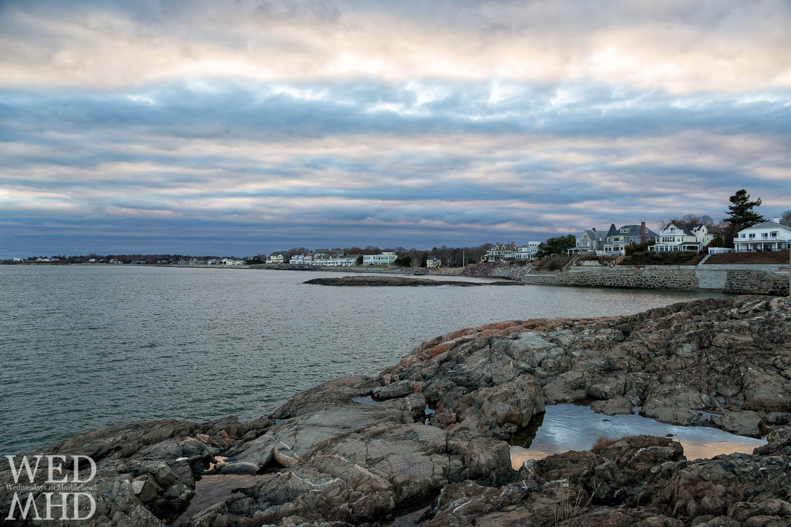 Sunset is captured in a tide pool on New Years Day in Marblehead