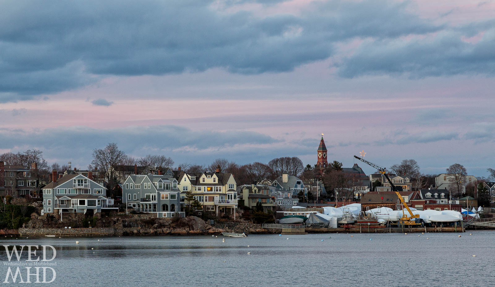 A shining star atop a crane hangs near Abbot Hall in this sunset view of Marblehead's skyline