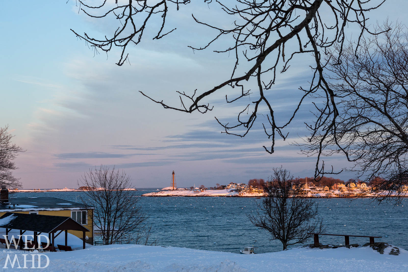 Golden light spreads over Marblehead Neck in this view from Crocker Park after the storm