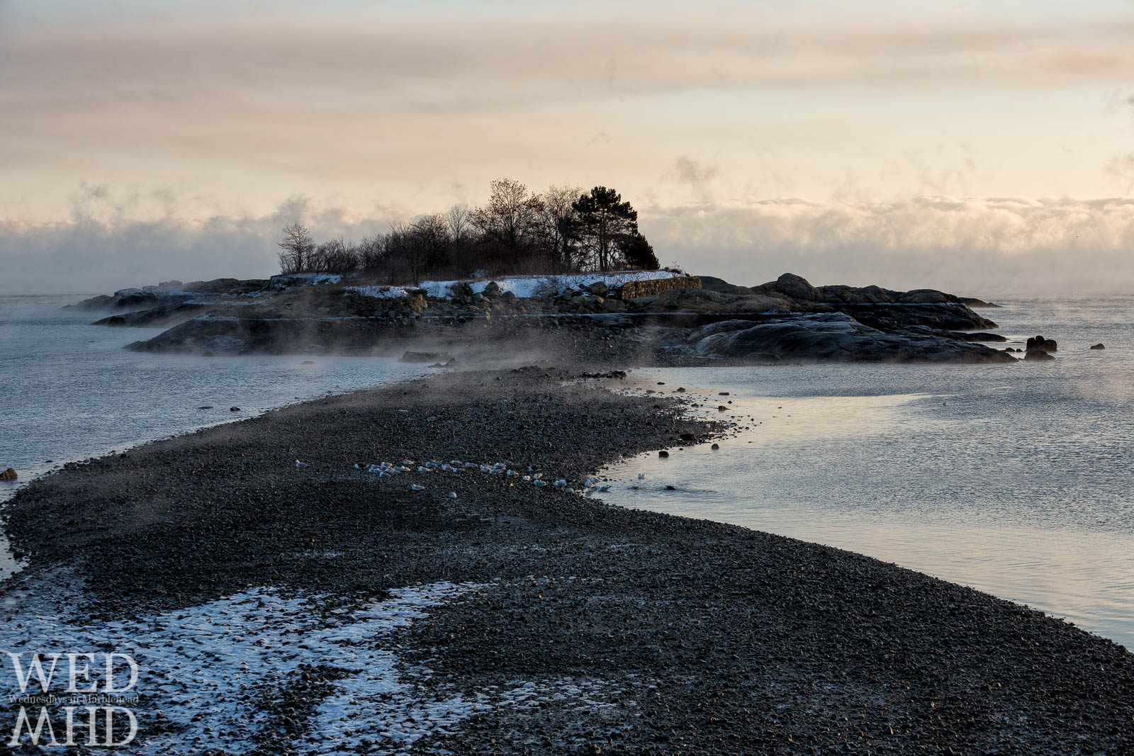 Gerry Island is bathed in sea smoke on an arctic morning in Marblehead