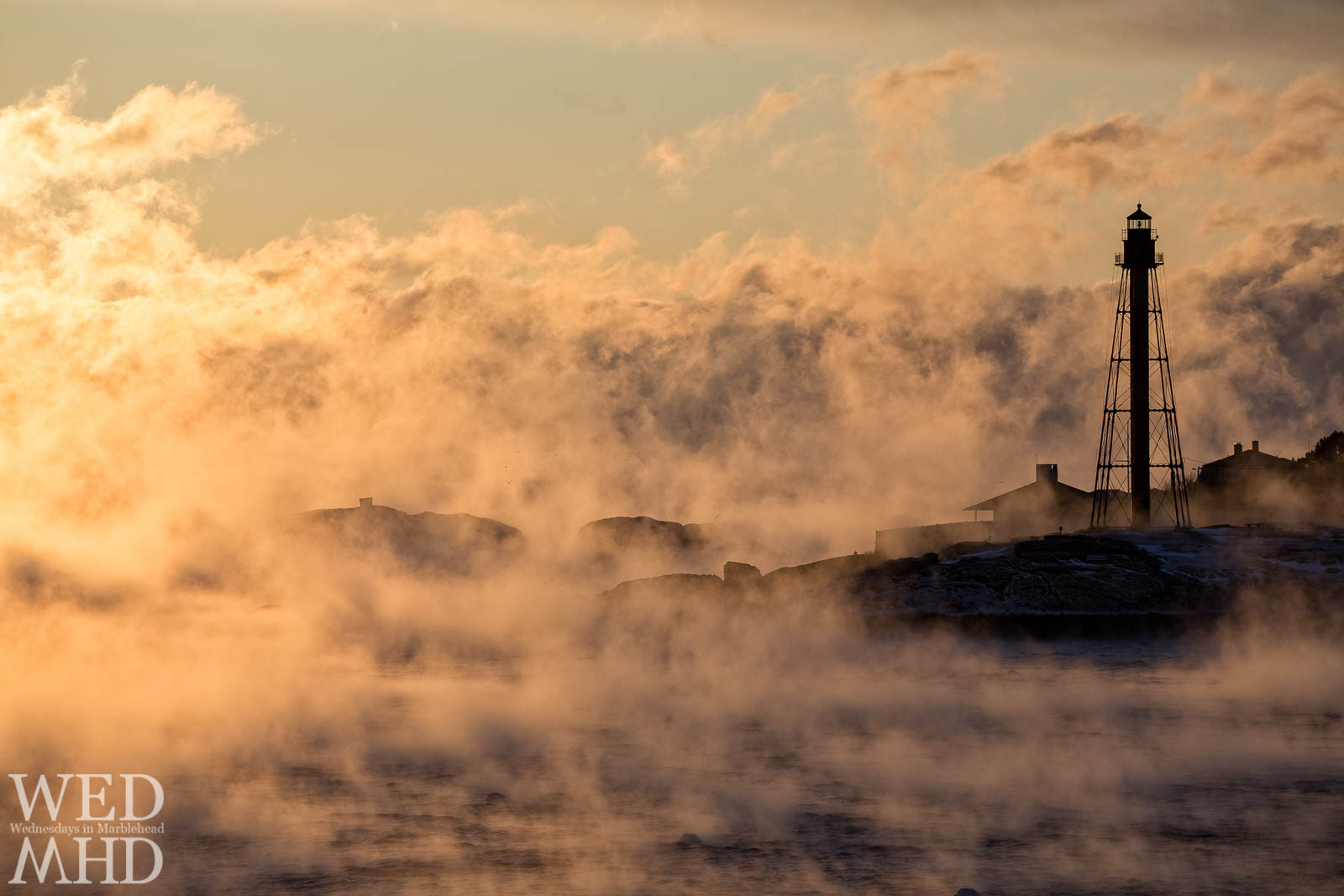 Pillars of sea smoke rise from Marblehead Harbor as arctic air causes steam to form from ocean water