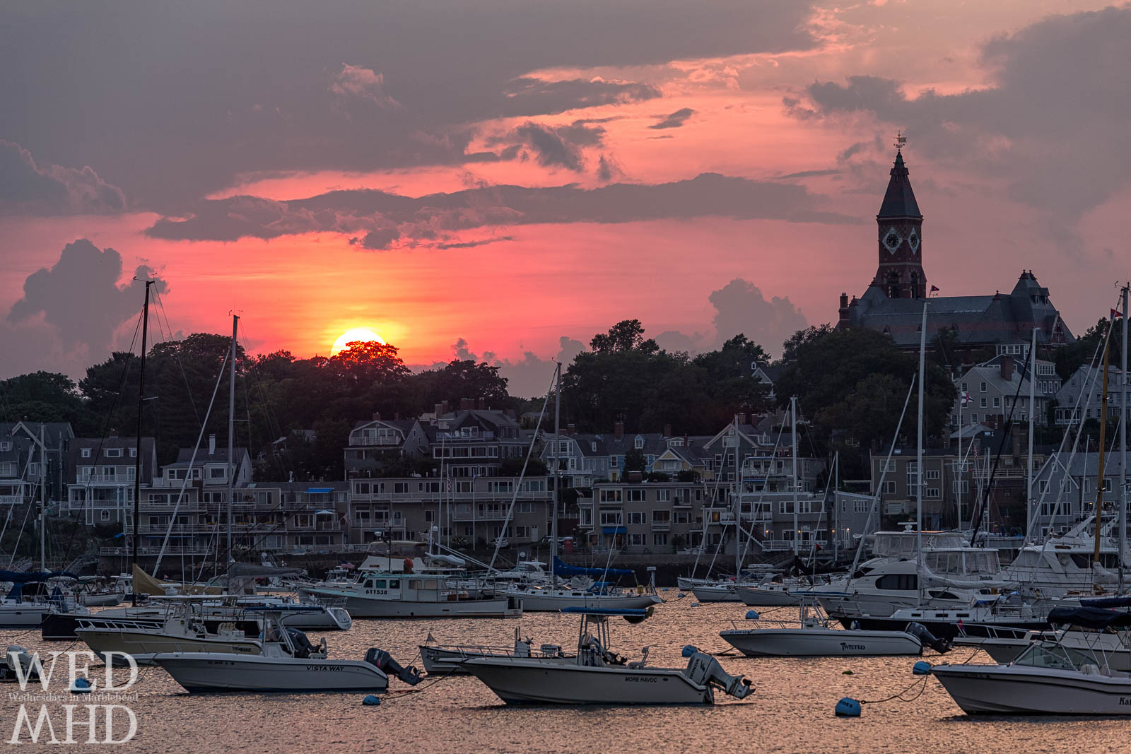 A red sky forms at sunset over Marblehead Harbor during the warmer days of Summer