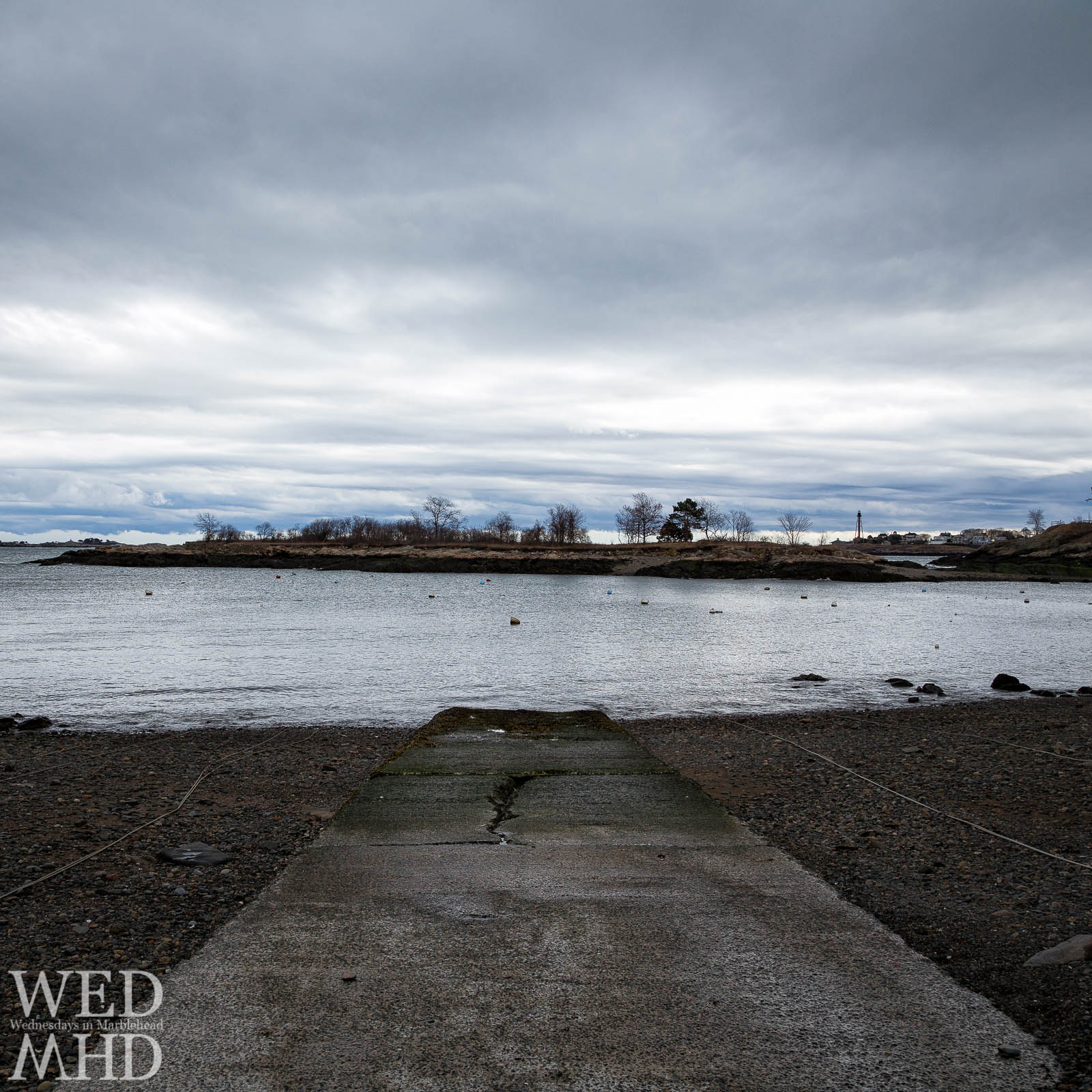 A boat ramp  in the area known as Barnegat leads into First Harbor and Gerry Island under grey skies