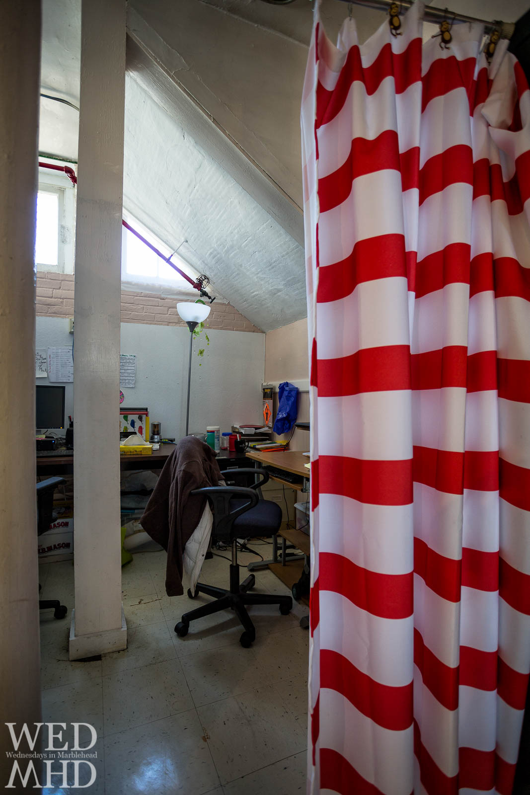 Two offices are seperated from the art room and basement gymnasium by a shower curtain at the Gerry School