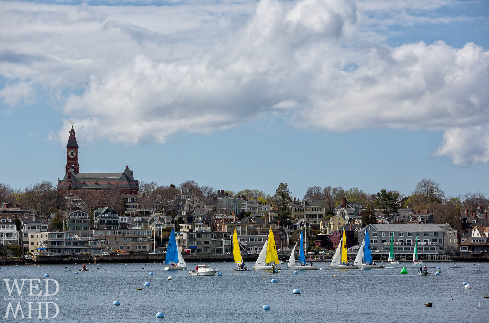 Light breeze, picturesque clouds and colorful boats make for a perfect day for racing during the Jackson Cup