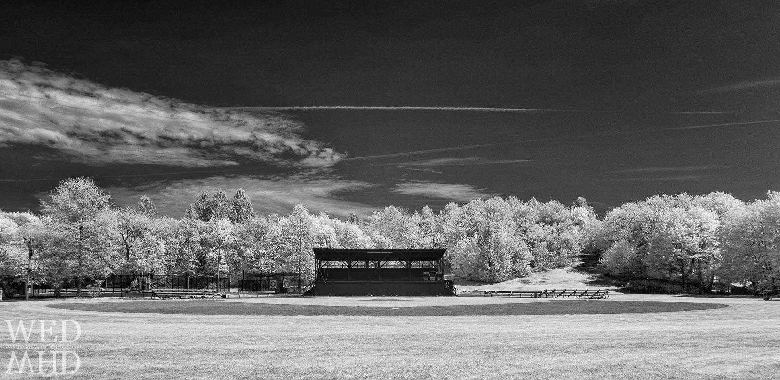 The grandstand at Seaside Park welcomes folks to enjoy a game of baseball in this black and white infrared image