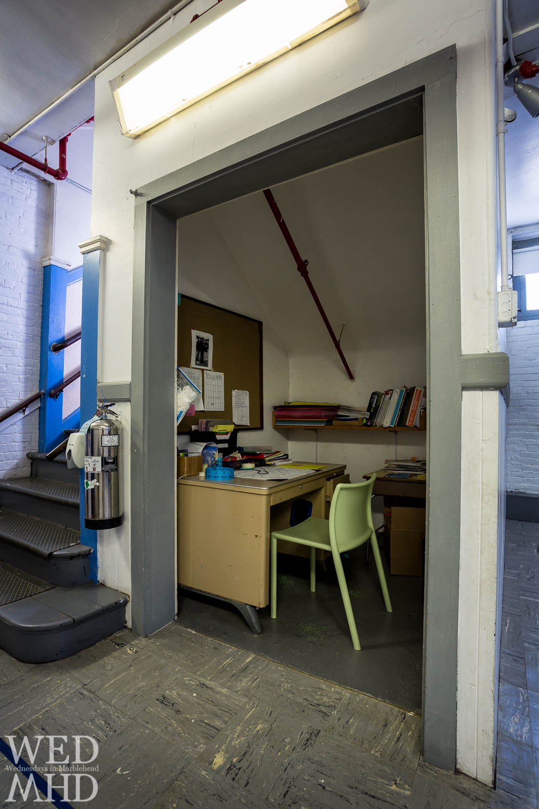 An office located under the stairs in the basement of the Gerry School