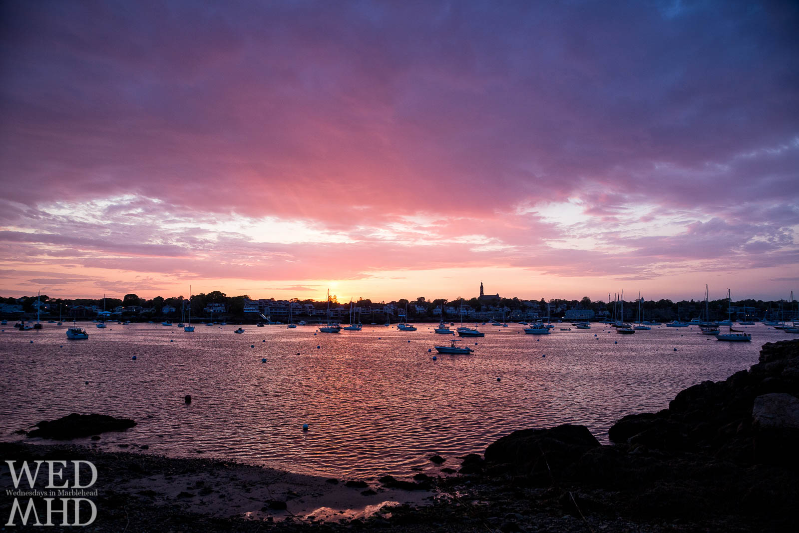 A perfect sunset is accompanied by a warm breeze as the first breath of Summer passes through Marblehead