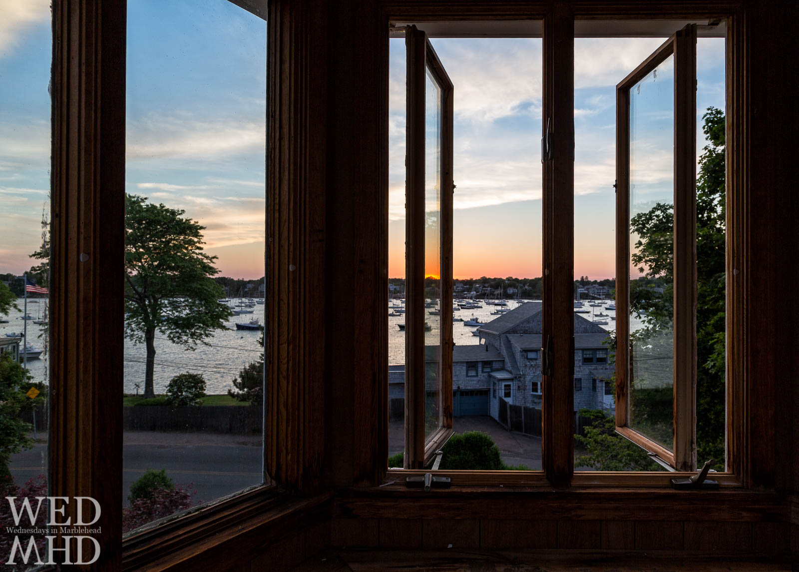 A commissioned Marblehead house portrait captures the timeless view out the windows of a cupola on Harbor Avenue