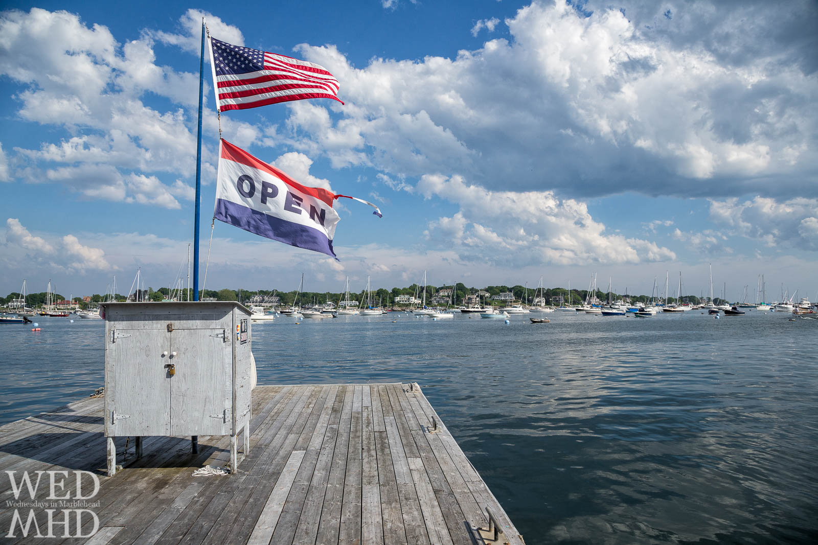 A flag proclaims Marblehead harbor is open for the season