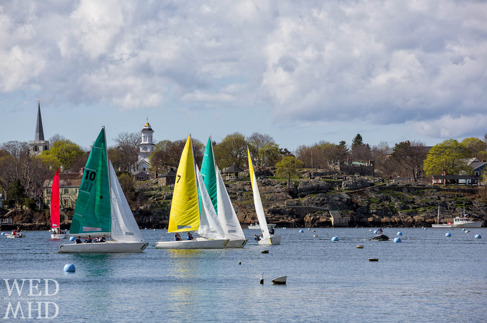 A group of sailboats participates in the Jackson Cup racing in Marblehead Harbor